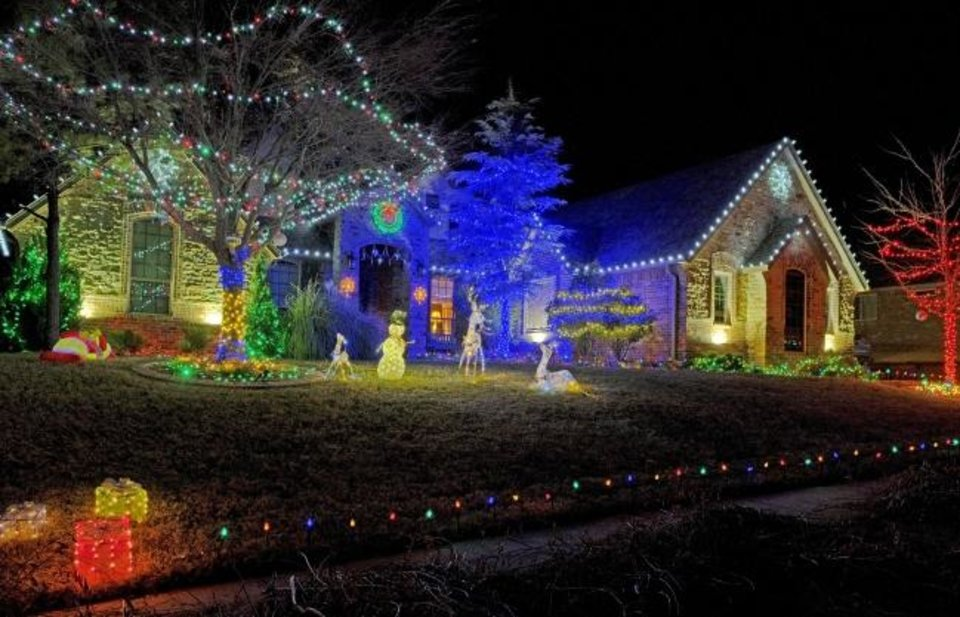 Photo -  Christmas decorations at 19801 Stratmore Way in Edmond. [DOUG HOKE/THE OKLAHOMAN]