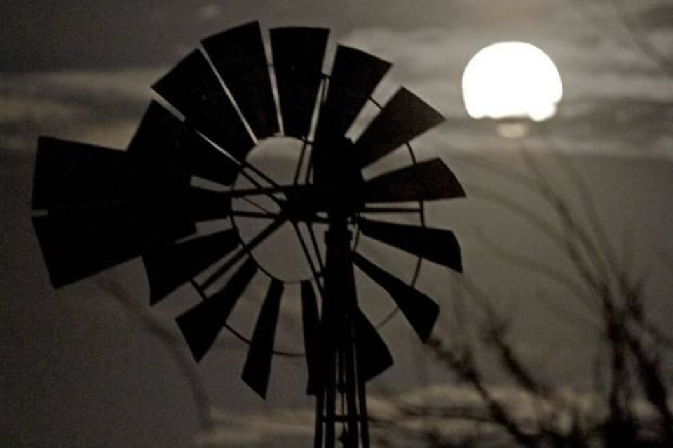 Photo - A full moon is seen next to a windmill in Oklahoma City on March 19, 2011. Photo by Bryan Terry, The Oklahoman
