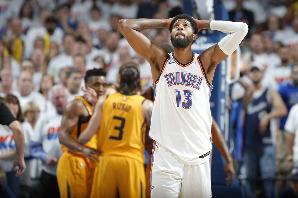 dfa0d78ce048 Oklahoma City s Paul George (13) looks up after a Utah foul during Game 2 of  the first round NBA playoff series between the Oklahoma City Thunder and  the ...