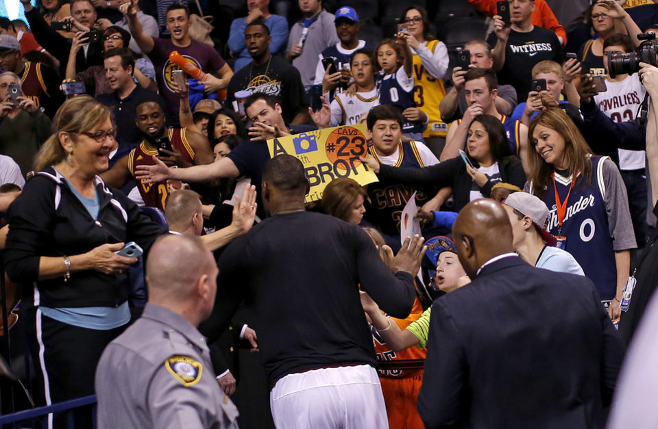 Photo - Fans gather to meet Cleveland's LeBron James after an NBA basketball game between the Oklahoma City Thunder and the Cleveland Cavaliers at Chesapeake Energy Arena in Oklahoma City, Sunday, Feb. 21, 2016. Oklahoma City lost 115-92.  Photo by Bryan Terry, The Oklahoman