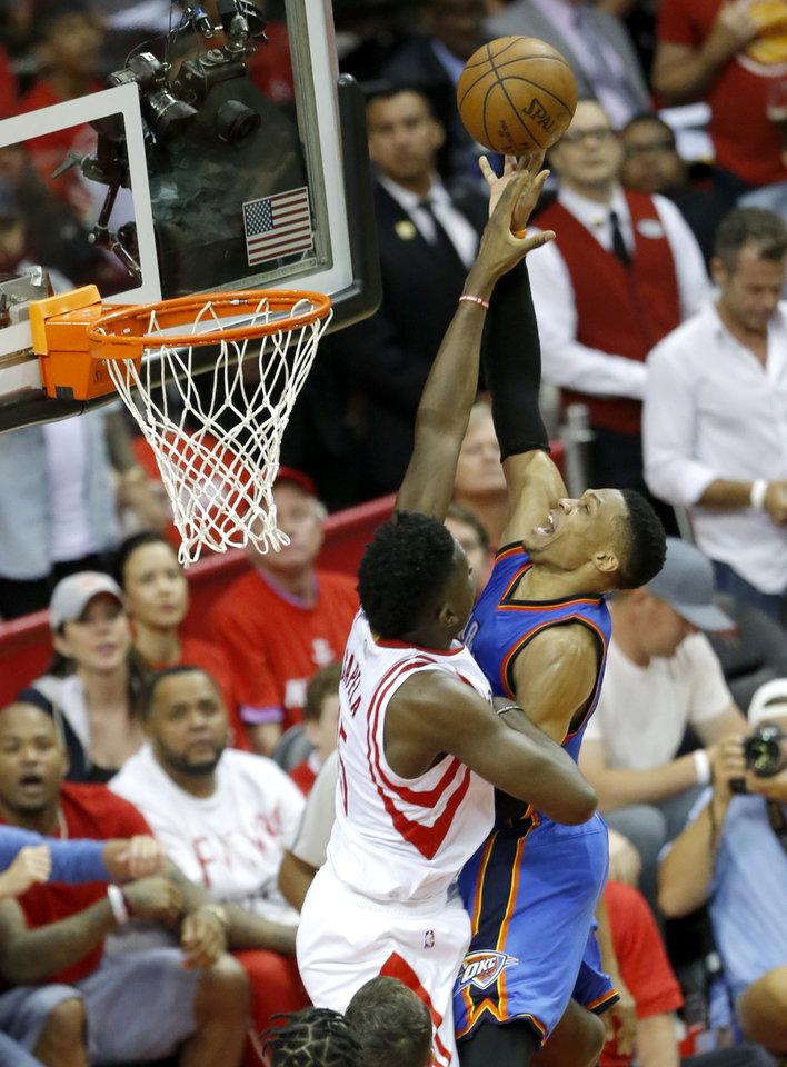 Photo - Oklahoma City's Russell Westbrook (0) shoots as Houston's Clint Capela (15) defends during Game 2 in the first round of the NBA playoffs between the Oklahoma City Thunder and the Houston Rockets in Houston, Texas,  Wednesday, April 19, 2017.  Photo by Sarah Phipps, The Oklahoman