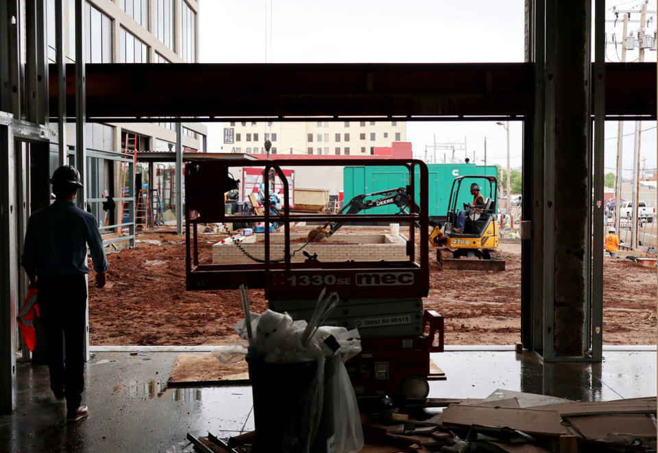 Photo - Heartland building progress in downtown at 5th and Broadway, Wednesday, May 13, 2020. [Doug Hoke/The Oklahoman]