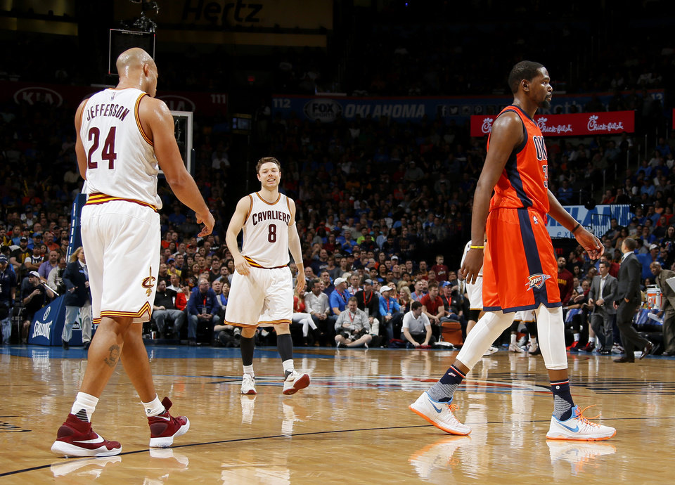 Photo - Oklahoma City's Kevin Durant (35) walks by Cleveland's Richard Jefferson (24) and Matthew Dellavedova (8) after a time out during an NBA basketball game between the Oklahoma City Thunder and the Cleveland Cavaliers at Chesapeake Energy Arena in Oklahoma City, Sunday, Feb. 21, 2016. Oklahoma City lost 115-92.  Photo by Bryan Terry, The Oklahoman