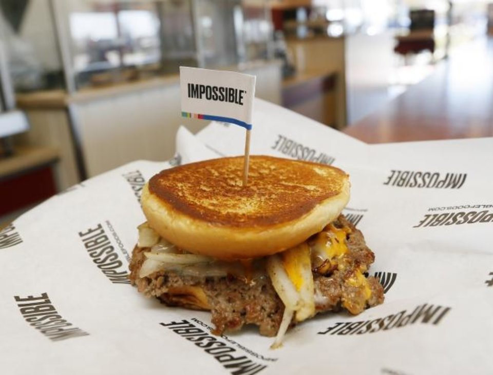 Photo -  The plant-based Impossible Melt is shown at Wayback Burgers in Edmond. [Nate Billings/The Oklahoman]