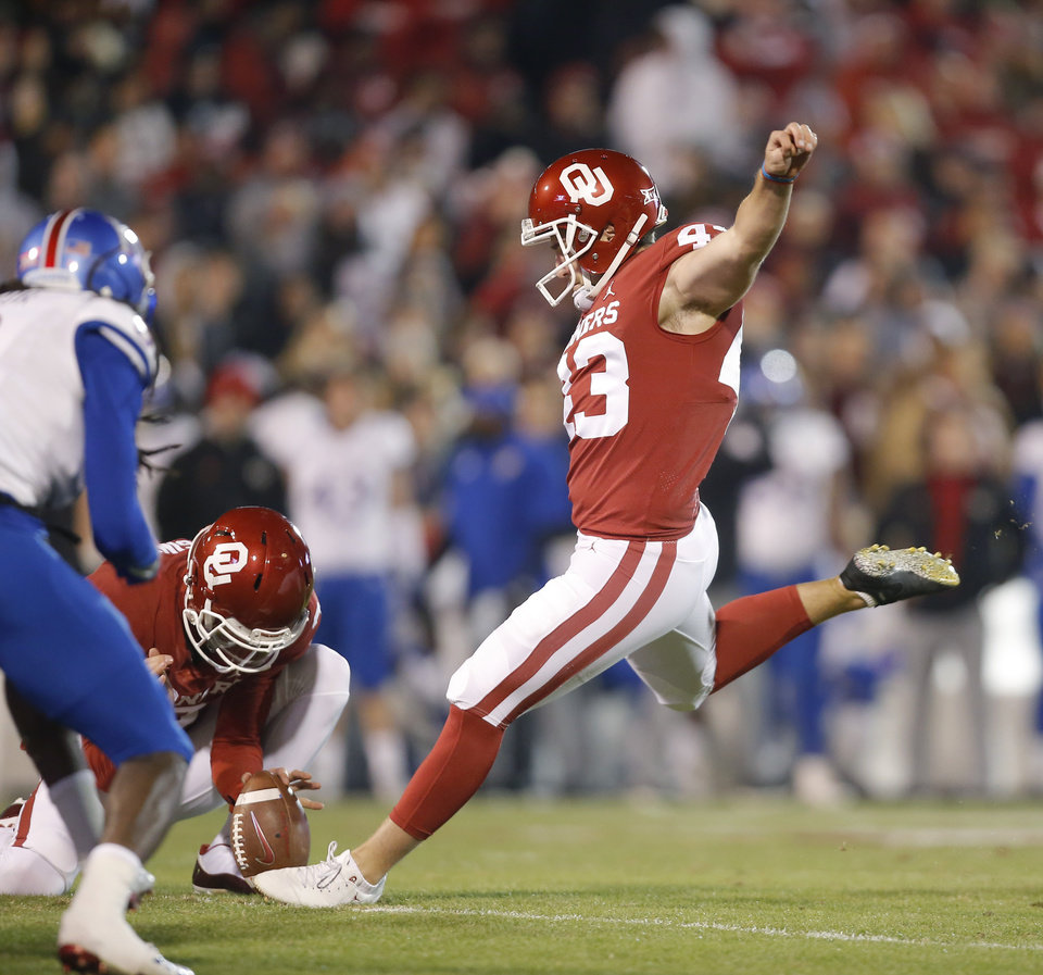 Photo - Oklahoma's Austin Seibert (43) kicks an extra point during a college football game between the University of Oklahoma Sooners (OU) and the Kansas Jayhawks (KU) at Gaylord Family-Oklahoma Memorial Stadium in Norman, Okla., Saturday, Nov. 17, 2018. Photo by Bryan Terry, The Oklahoman