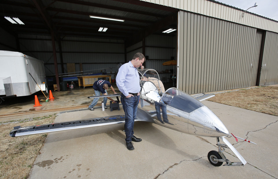 Luxury Sundance Airport CEO Jerry Hunter looks at a FLS Microjet that is hangared at the northwest Oklahoma City airport which he recently purchased