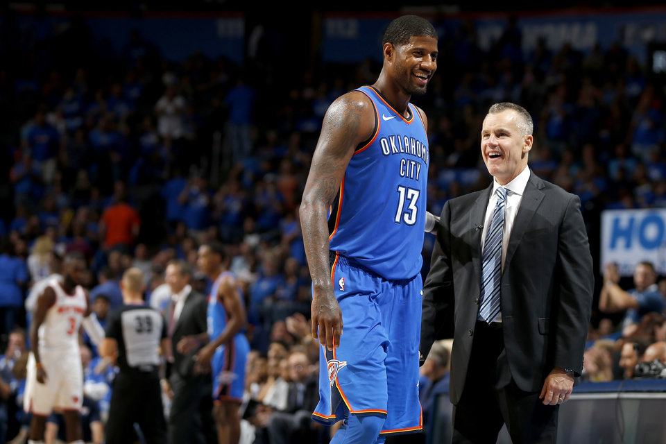 Photo - Oklahoma City coach Billy Donovan talks with Paul George (13) as he exits the game during an NBA basketball game between the Oklahoma City Thunder and the New York Knicks at Chesapeake Energy Arena in Oklahoma City, Thursday, Oct. 19, 2017.  Oklahoma City won 105-84. Photo by Bryan Terry, The Oklahoman