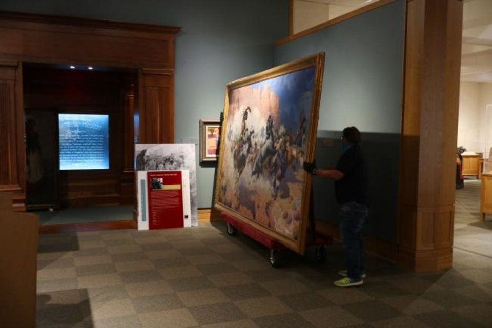 Photo - Employees remove the painting