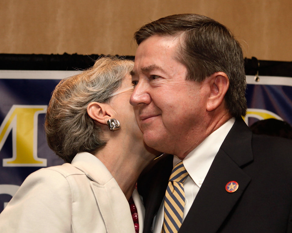 Photo - Linda Edmondson gives husband, Drew, a kiss after he delivered his concession speech to supporters at gubernatorial primary election watch party for Drew Edmondson at the Sheraton Hotel in downtown Oklahoma City, Tuesday, July 27, 2010.  Photo by Jim Beckel, The Oklahoman