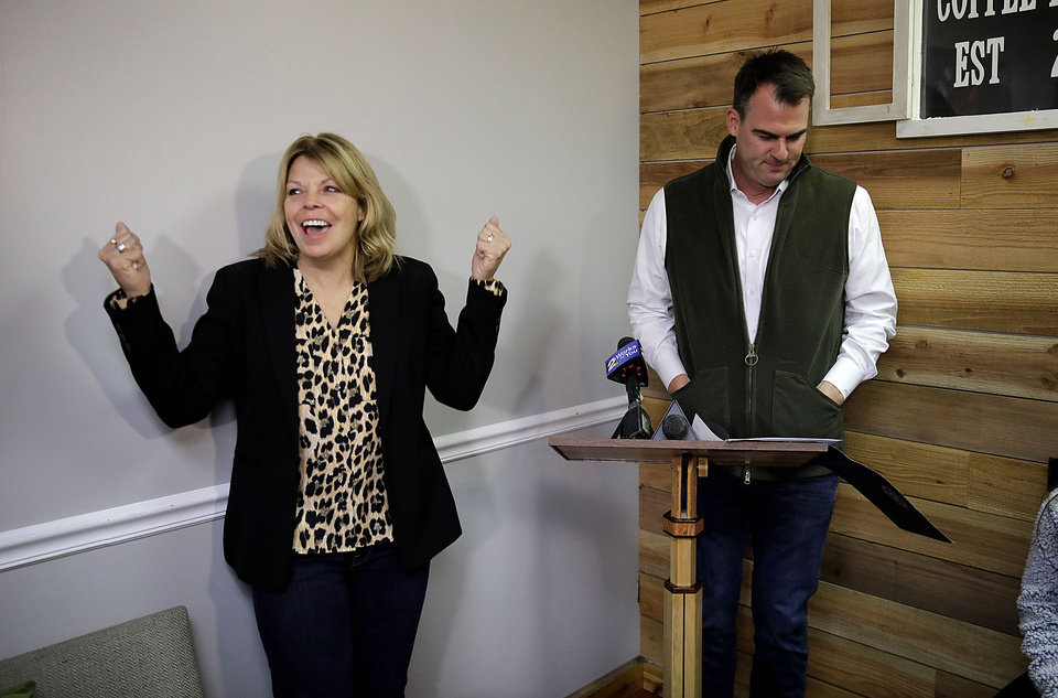 Photo - Rhonda Bear cheers as Oklahoma Gov. Kevin Stitt speaks shortly before signing her pardon at She Brews Coffee House in Claremore Thursday, Nov. 7, 2019. MIKE SIMONS/Tulsa World