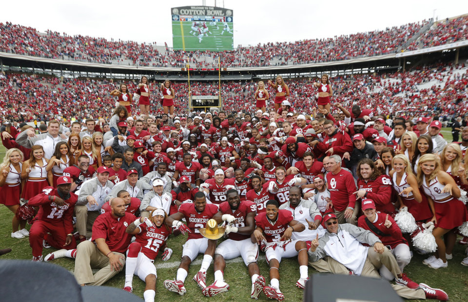 Photo - The Sooners gather for a team photo after the 31-26 win over Texas during the college football game between the University of Oklahoma Sooners (OU) and the University of Texas Longhorns (UT) during the Red River Showdown at the Cotton bowl in Dallas, Texas on Saturday, Oct. 11, 2014. Photo by Chris Landsberger, The Oklahoman