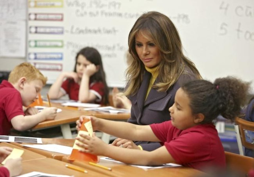 Photo -  Melania Trump talks with second-grader Madison Phillips during a visit Monday to Dove School of Discovery in Tulsa. Trump is in Oklahoma to open a three-state tour to highlight all three components of her