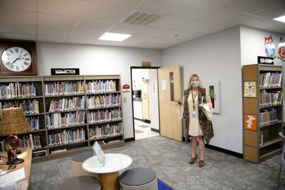 Photo -  Assistant Director of Alternative Education Linda Mace leads a tour of Norman Public Schools' Dimensions Academy building that houses the district's alternative education program in Norman, Okla., Tuesday, Jan. 5, 2021. [Sarah Phipps/The Oklahoman]