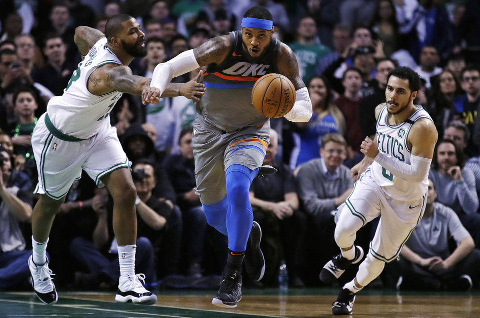 Photo -  Fouled on this play with 8.4 seconds to play on Tuesday, the Thunder's Carmelo Anthony, center, missed two free throws that likely would have iced an Oklahoma City win at Boston. [AP PHOTO]