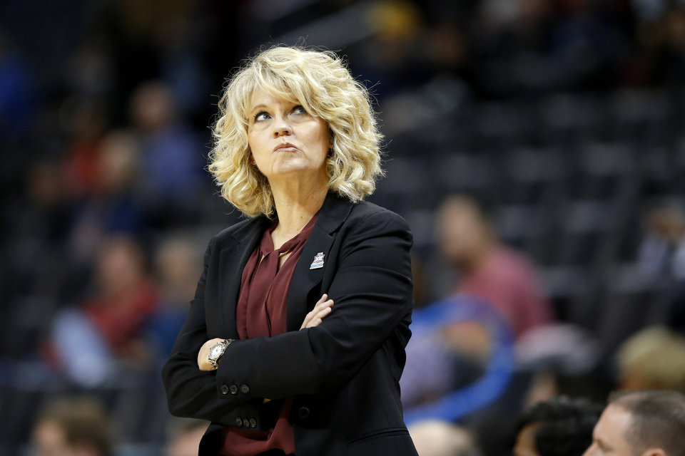 Photo - Oklahoma coach Sherri Coale looks up during a game between the University of Oklahoma (OU) and Texas Tech in the first round of the women's Big 12 basketball tournament at Chesapeake Energy Arena in  Oklahoma City, Friday, March 8, 2019. Texas Tech won 104-84. Photo by Bryan Terry, The Oklahoman