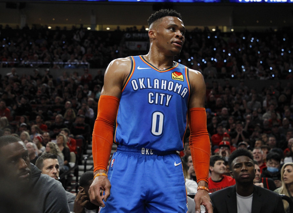 Photo - Oklahoma City Thunder guard Russell Westbrook interacts with the crowd during the first half of Game 1 of a first-round NBA basketball playoff series against the Portland Trail Blazers in Portland, Ore., Sunday, April 14, 2019. (AP Photo/Steve Dipaola)