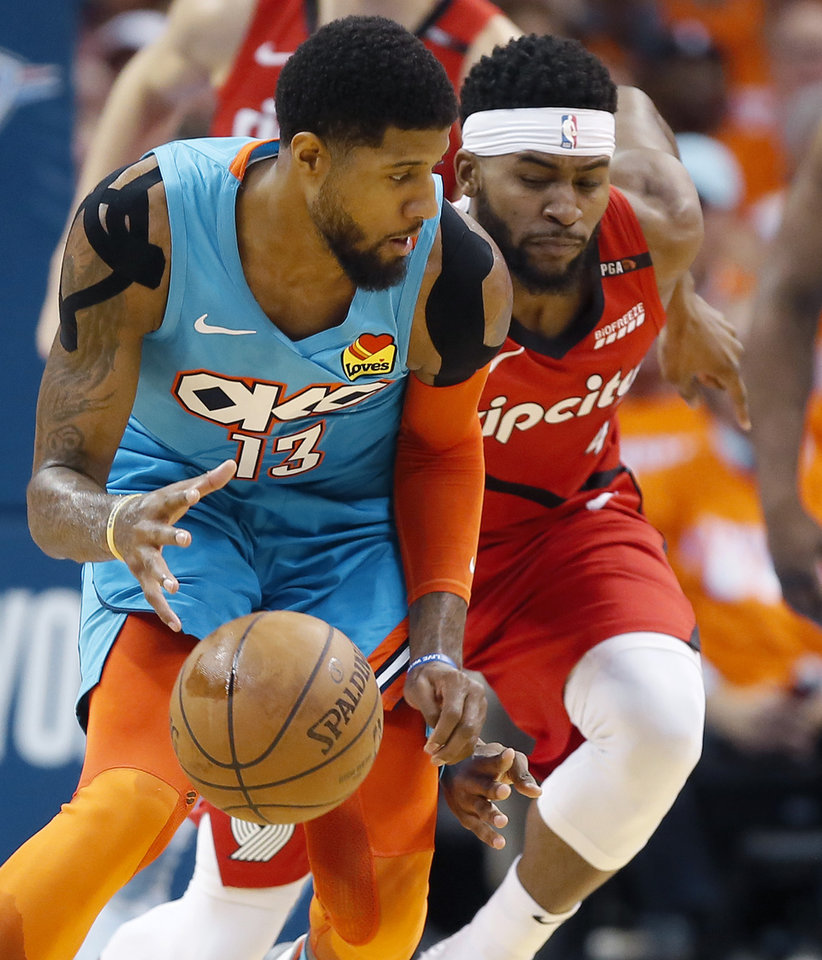 Photo - Oklahoma City's Paul George (13) goes for the ball beside Portland's Maurice Harkless (4) during Game 3 in the first round of the NBA playoffs between the Portland Trail Blazers and the Oklahoma City Thunder at Chesapeake Energy Arena in Oklahoma City, Friday, April 19, 2019. Photo by Bryan Terry, The Oklahoman