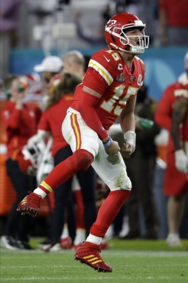Photo -  Kansas City Chiefs' quarterback Patrick Mahomes celebrates his touchdown pass to  Damien Williams in the the second half of the Super Bowl. [AP Photo/John Bazemore]
