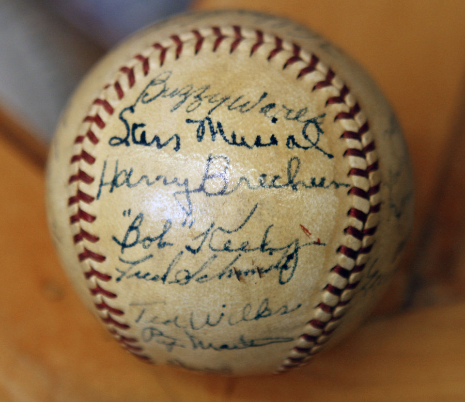 Photo - BASEBALL COLLECTION: STAN MUSIAL: This is one of the items in a collection of autographed baseballs on display at the Oklahoma Sports Hall of Fame in Guthrie, OK, Thursday, April 11, 2013,  By Paul Hellstern, The Oklahoman