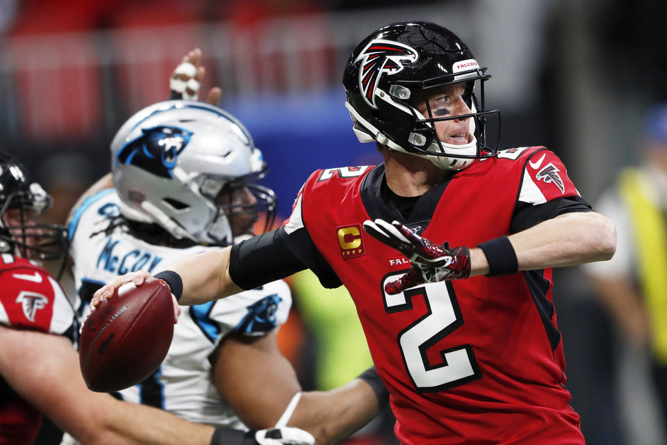 Photo - FILE - In this Dec. 8, 2019, file photo, Atlanta Falcons quarterback Matt Ryan (2) works in the pocket against the Carolina Panthers during the first half of an NFL football game in Atlanta. Ryan joined other Falcons players in a video that noted the legacy of the civil rights icon John Lewis, whose death last month reacquainted Americans with an enormously consequential figure in the fight for voting rights and social justice. (AP Photo/John Bazemore, File)