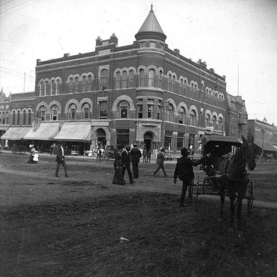 Photo -  First home of The Oklahoman, 101 W Main Street, Circa 1894-1895. Sam Small was the son of a newspaper editor, and had himself penned a column for the Atlanta Journal Constitution before his adventures took him to Oklahoma City where he published the first issue of The Oklahoman in January, 14, 1894. The newspaper office opened in the basement of the brand new Masonic Lodge at 101 W Main Street, while the paper was printed at 1 N Robinson Ave., where Frank McMaster had printed The Evening Gazette since May, 1889. Small introduced Associated Press coverage from around the world and boasted newspapers were being sold in New York City, Chicago, Cincinnati and Washington, D.C. Small's operation lost money, and on July 1, 1894 the The Oklahoman and Evening Gazette were merged under new ownership led by Charles Barrett. Photo courtesy of the Metropolitan Library System