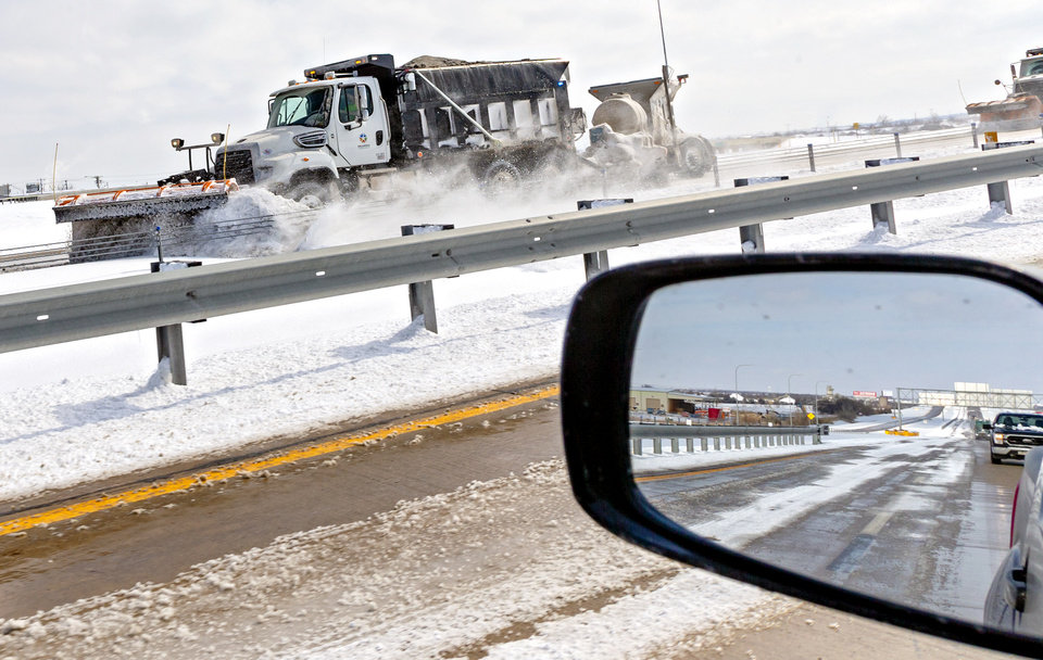 Photo - Crews work to clear snow from the Kilpatrick Turnpike Oklahoma City, Okla. on Wednesday, Feb. 17, 2021.  [Chris Landsberger/The Oklahoman]