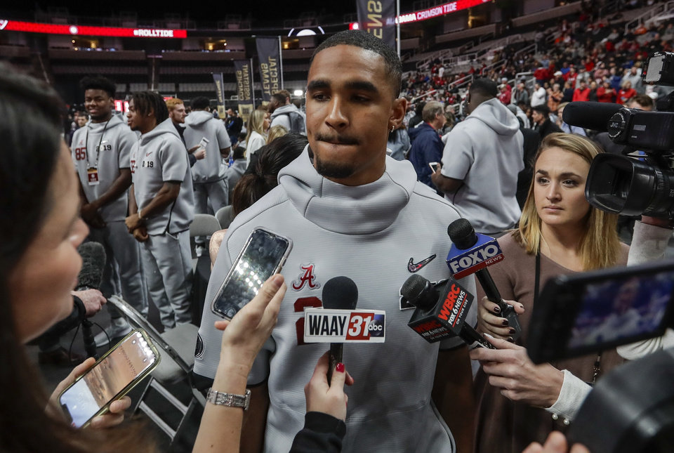 Alabama s Jalen Hurts answers questions during media day for the NCAA  college football playoff championship game Saturday 690122417