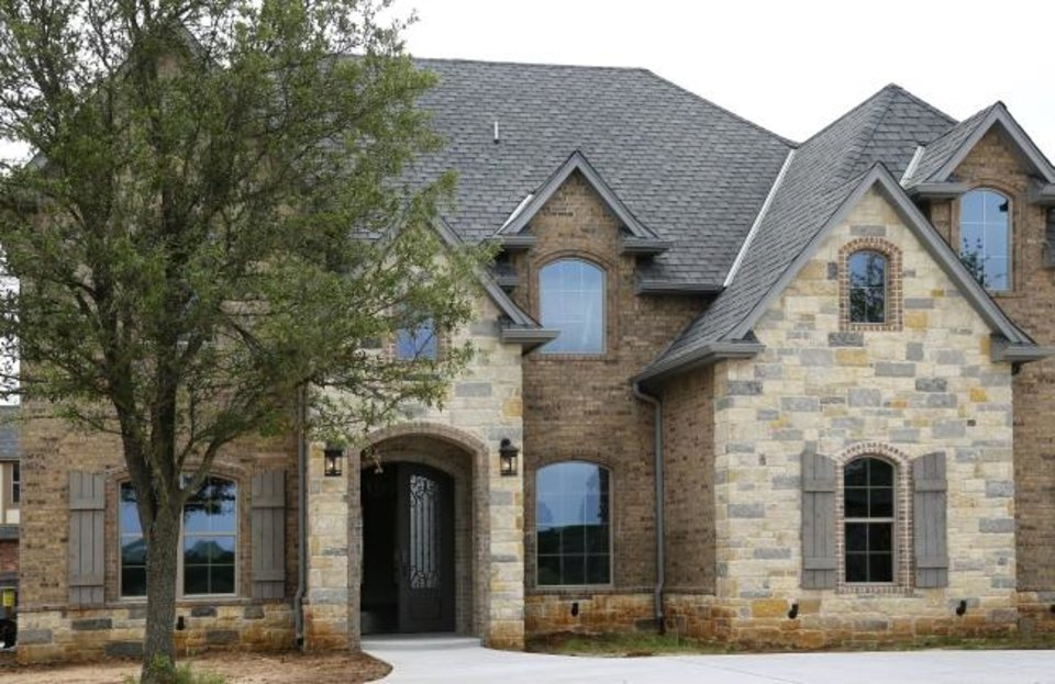 Photo -  Craig Smith Building just finished this 4,106-square-foot, four-bedroom, four-bath home at 12901 Endor Court, in the Rivendell neighborhood. Tours of the decked-out home June 8-23 will raise money for The Sparrow Project. [JIM BECKEL, THE OKLAHOMAN]