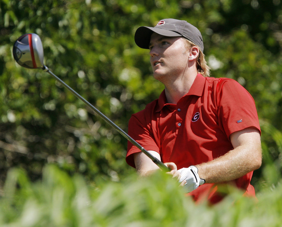 Photo - Russell Henley of Georgia watches his tee shot on No. 14 during the team match final of the NCAA Division I Men's Golf Championship at Karsten Creek Golf Course in Stillwater, Okla., Sunday, June 5, 2011.  Augusta State beat Georgia, 3-2. Photo by Nate Billings, The Oklahoman