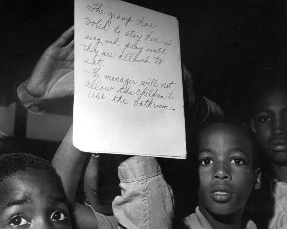 Photo -  Demonstrators inside Bishop's Restaurant in in Oklahoma City wrote notes like this to display on the eatery's windows. The 1963 demonstration was one of many of its kind during Oklahoma's civil rights movement. Oklahoman Archive