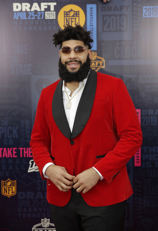 Photo - Oklahoma tackle Cody Ford walks the red carpet ahead of the first round at the NFL football draft, Thursday, April 25, 2019, in Nashville, Tenn. (AP Photo/Mark Humphrey)