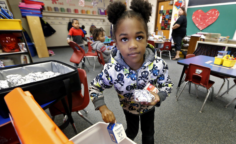 Photo - Highland Park Elementary pre-k student Promise Birchmeir gathers her breakfast as part of the new Breakfast in the Classroom program on Friday, March 30, 2018 in Midwest City, Okla.  Photo by Steve Sisney, The Oklahoman