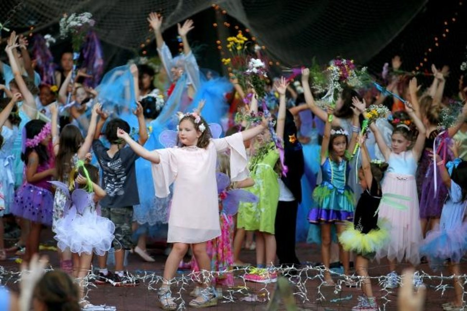 Photo -  Children dance on stage during the 2019 Fairy Ball. [Bryan Terry/The Oklahoman]