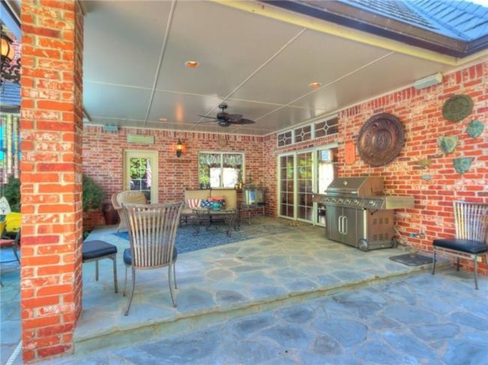 Photo -  Covered patio at 4104 Ramsey Road in Yukon, the Listing of the Week. [PHOTO PROVIDED]