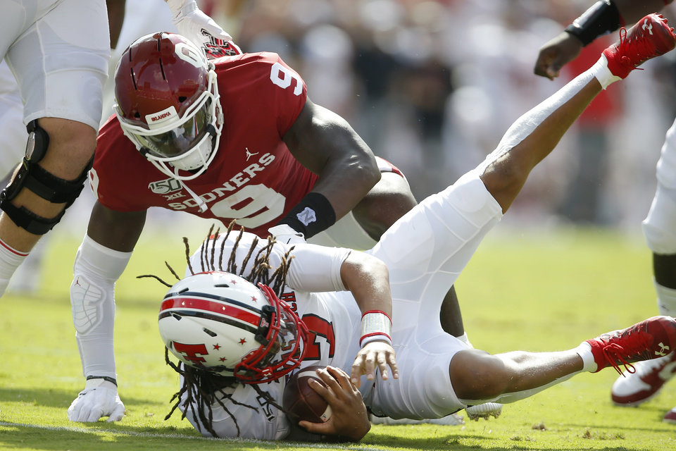 Photo - Oklahoma's Kenneth Murray (9) brings down Jett Duffey (7) during a college football game between the University of Oklahoma Sooners (OU) and Texas Tech University at Gaylord Family-Oklahoma Memorial Stadium in Norman, Okla., Saturday, Sept. 28, 2019. [Bryan Terry/The Oklahoman]