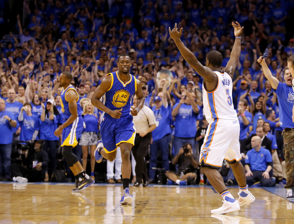 Photo - Oklahoma City's Dion Waiters (3) celebrates a 3-point basket next to Golden State's Harrison Barnes (40) during Game 6 of the Western Conference finals in the NBA playoffs between the Oklahoma City Thunder and the Golden State Warriors at Chesapeake Energy Arena in Oklahoma City, Saturday, May 28, 2016. Photo by Sarah Phipps, The Oklahoman