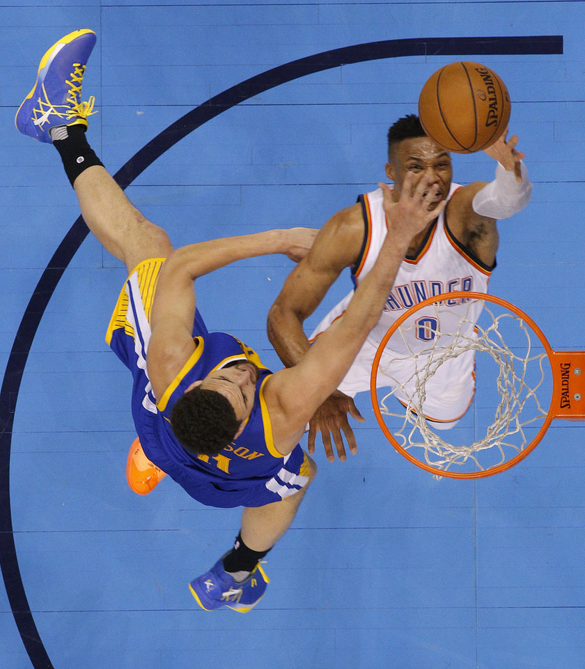 Photo - Oklahoma City's Russell Westbrook (0) goes past Golden State's Klay Thompson (11) during Game 3 of the Western Conference finals in the NBA playoffs between the Oklahoma City Thunder and the Golden State Warriors at Chesapeake Energy Arena in Oklahoma City, Sunday, May 22, 2016. Oklahoma City won 133-105. Photo by Bryan Terry, The Oklahoman