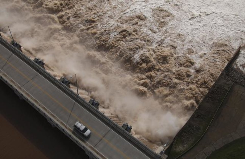 Photo -  Water is released Friday from the Keystone Dam into the Arkansas River northwest of Tulsa. The U.S. Army Corps of Engineers began increasing the amount of water being released from the dam on Friday to control the flooding. [Tom Gilbert/Tulsa World]