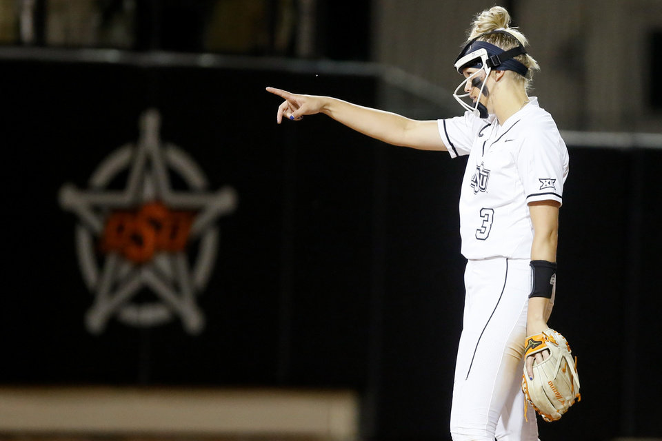 Photo - Oklahoma State's Samantha Show (3) gestures after an out in the seventh inning of the Stillwater Regional NCAA softball tournament game between Oklahoma State (OSU) and BYU in Stillwater, Okla., Thursday, May 16, 2019. Oklahoma State won 3-1. [Bryan Terry/The Oklahoman]