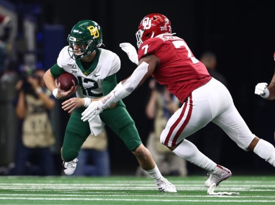 Photo -  OU defensive end Ronnie Perkins (7) pressures Baylor quarterback Charlie Brewer during last season's Big 12 championship game in Arlington, Texas. [Matthew Emmons/USA TODAY Sports]