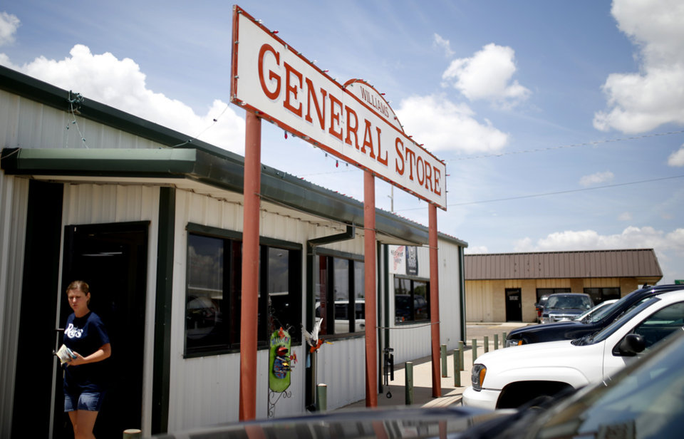 Photo - A customer exits Williams General Store in Muleshoe, Texas, hometown of Oklahoma's offensive coordinator Lincoln Riley, on Thursday, June 25, 2015. Photo by Bryan Terry, The Oklahoman