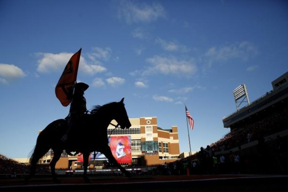 Photo -  Bullet celebrates a touchdown during a 2018 game. The famous horse was originally sitting out OSU games this season. Instead, Bullet will ride like normal. [Sarah Phipps/The Oklahoman]