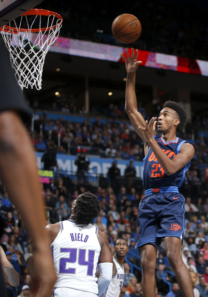 Photo - Oklahoma City's Terrance Ferguson (23) puts up a shot over Sacramento's Buddy Hield (24) during an NBA basketball game between the Oklahoma City Thunder and the Sacramento Kings at Chesapeake Energy Arena in Oklahoma City, Sunday, Oct. 21, 2018. Photo by Bryan Terry, The Oklahoman