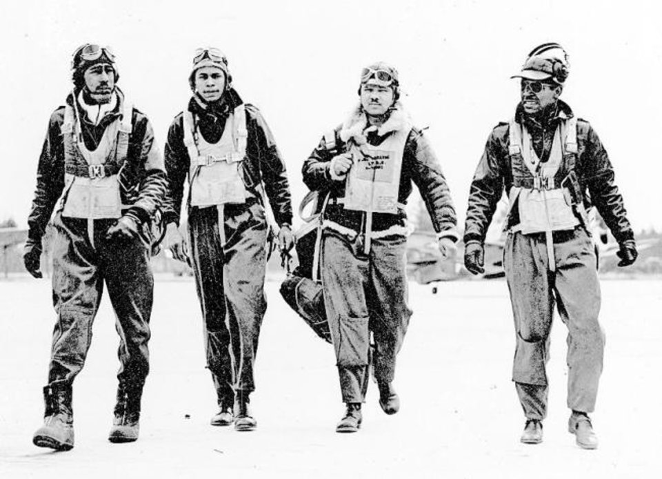 Photo -  Four pilots from the 332nd Fighter   Group are shown. [The Col. Roosevelt J. Lewis (USAF. RET) collection, Moton Field, Tuskegee]
