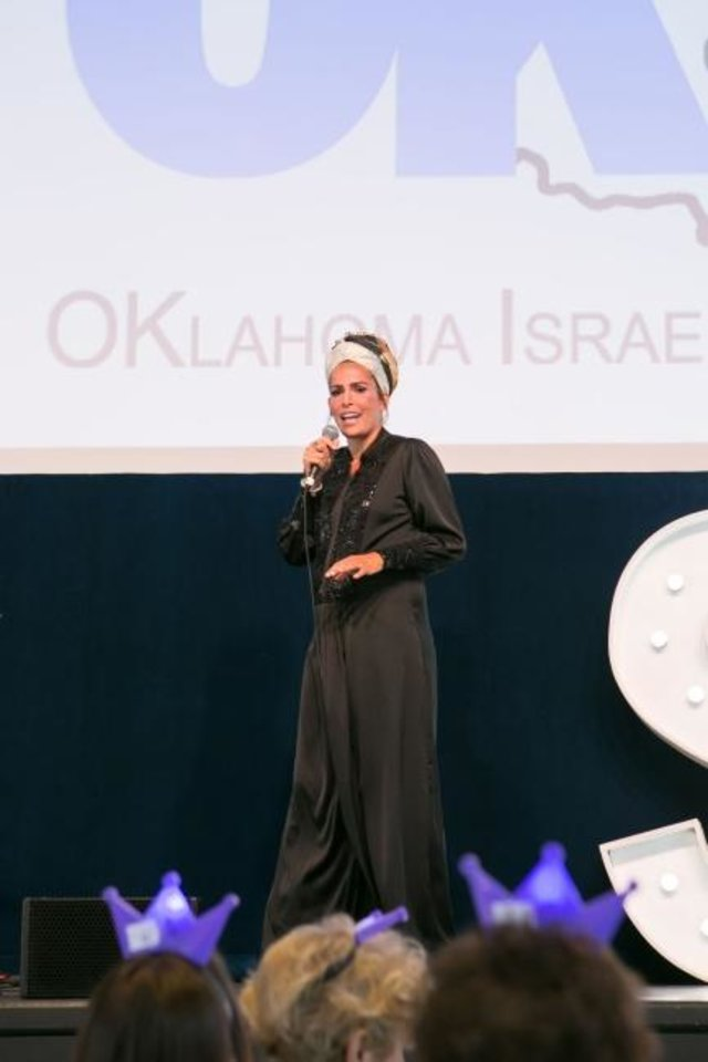 Photo -  Linor Abargil, a former Miss Israel who won the title of Miss World in 1998, speaks at the Oklahoma Israel Exchange's