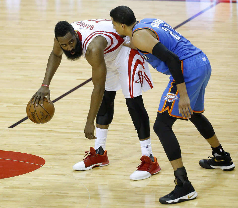 Photo - Houston's James Harden (13) looks to get around Oklahoma City's Andre Roberson (21) during Game 2 in the first round of the NBA playoffs between the Oklahoma City Thunder and the Houston Rockets in Houston, Texas,  Wednesday, April 19, 2017.  Photo by Sarah Phipps, The Oklahoman