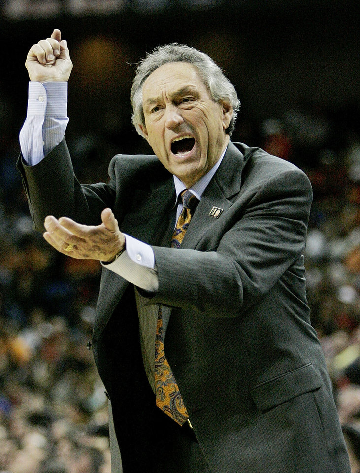 Photo - Kansas City, Mo - March 13, 2005 . (BIG 12 Tournament, Kemper Arena) Oklahoma State VS Texas Tech. Coach Eddie Sutton questions an officials call. Photo By Steve Gooch/The Oklahoman