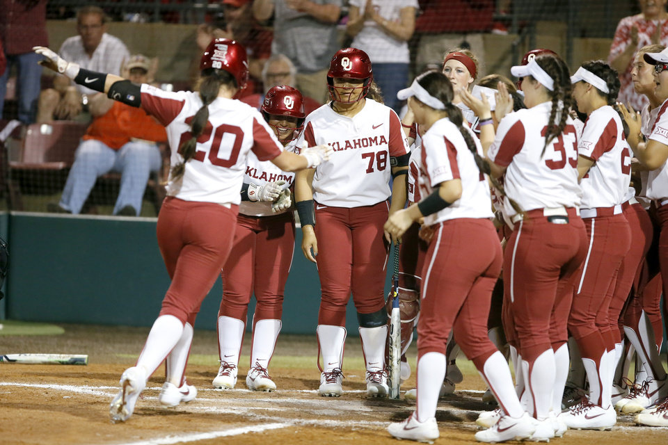Photo - Oklahoma's Caleigh Clifton (20) runs home after hitting a two-run home run in the third inning during the Norman Regional NCAA softball tournament game between the University of Oklahoma (OU) and UMBC in Norman, Okla., Friday, May 17, 2019. Oklahoma won 12-0.  [Bryan Terry/The Oklahoman]