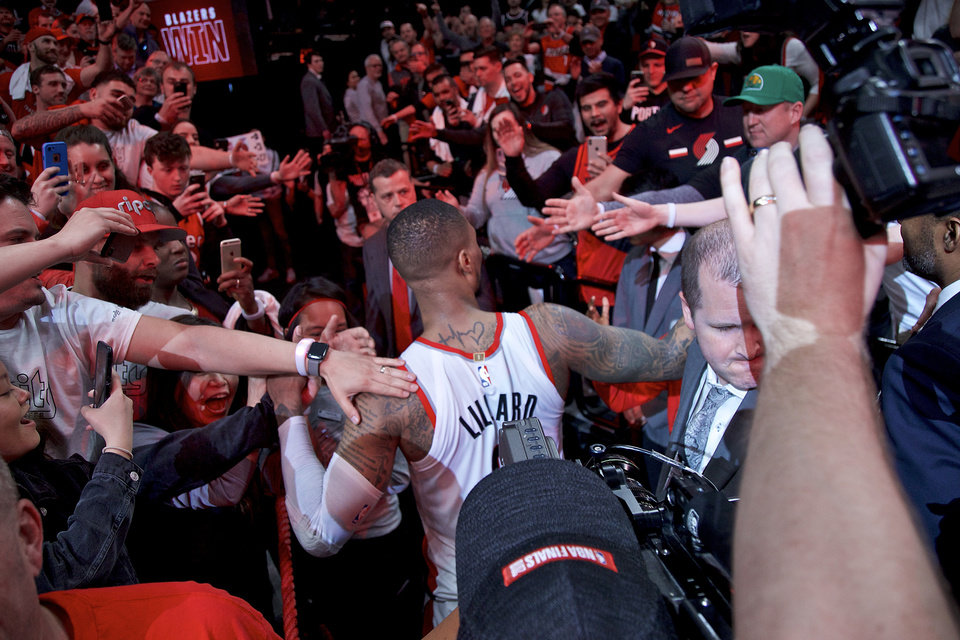 Photo - Portland Trail Blazers guard Damian Lillard walks off the court after Game 5 of an NBA basketball first-round playoff series against the Oklahoma City Thunder, Tuesday, April 23, 2019, in Portland, Ore. The Trail Blazers won 118-115. (AP Photo/Craig Mitchelldyer)