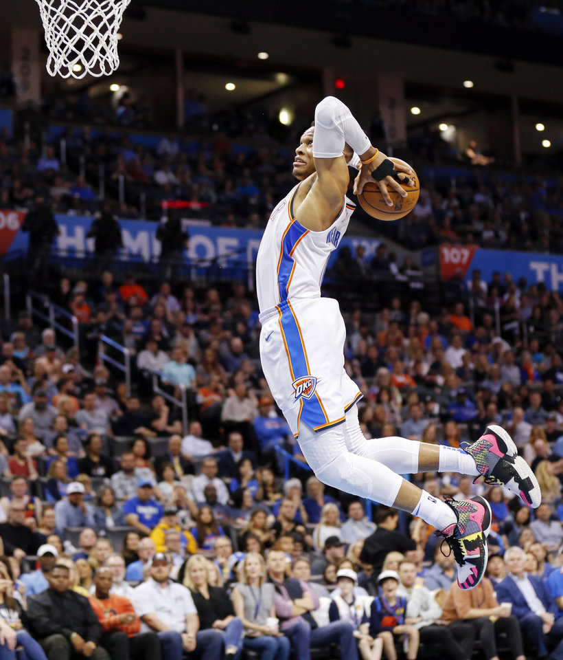 Photo - Oklahoma City's Russell Westbrook (0) dunks the ball in the second quarter during an NBA basketball game between the Detroit Pistons and the Oklahoma City Thunder at Chesapeake Energy Arena in Oklahoma City, Friday, April 5, 2019. Photo by Nate Billings, The Oklahoman